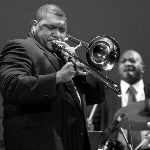 Wycliffe Gordon plays trombone during concert performance